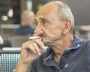 Photograph of an old man smoking