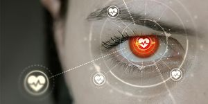 Closeup of human eye with illustrated representations of technology and health patterns