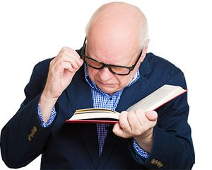 Photograph of man trying to read with glasses