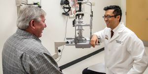 Dr. Augustine Hong gives patient Bobby Moyers an eye exam.