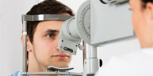 An ophthalmologist examines a patient's eyes.