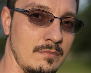 Photograph of a man wearing glasses with photochromic lenses