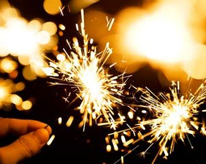 Closeup of a hand holding Fireworks - Sparkler