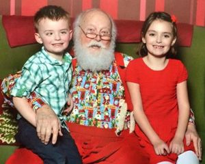 Jackson and his sister with Santa Claus in 2014.