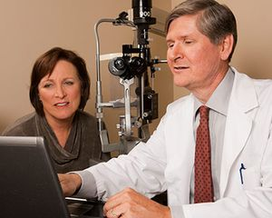 Photograph of patient and doctor discussing low vision resources