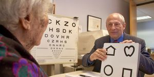 A low vision patient with her doctor