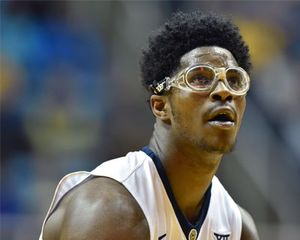 West Virginia Mountaineers forward Devin Williams (41) wears sports safety goggles as he prepares to shoot a free throw during a basketball game on November 13, 2015 in Morgantown, WV.