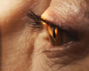 Closeup of eye being examined with new technology for detecting early Alzheimer's.
