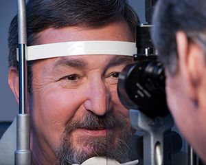 Photograph of a man having a complete eye exam