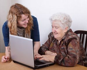 Younger woman and older woman together at laptop computer
