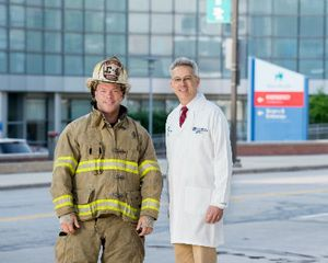Firefighter Jay Northup with his ophthalmologist Dr. Thomas Steinemann.