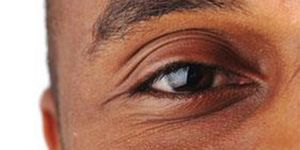 Close up of a man's eye with a brown iris
