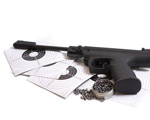 Photograph of airsoft gun, targets and plastic bullets