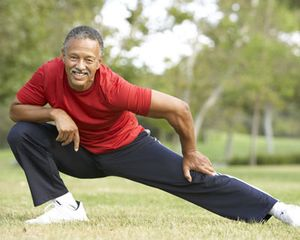 Photograph of a man stretching