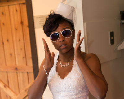 Te' Lavette wearing sunglasses on her wedding day, due to a contact lens-related eye infection.