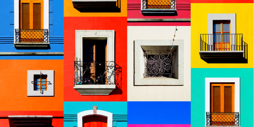 A collaged Image of beautifully and brightly colored windows and doors