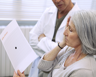 Woman Looking at Amsler Grid in Doctors Office