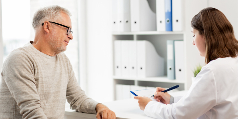 A man discusses his eye condition with his ophthalmologist.