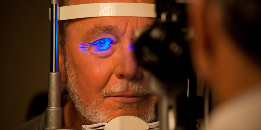 A patient having his eye pressure checked with a tonometer.