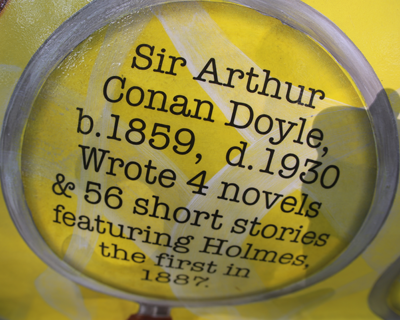 Sign reading: Sir Arthur Conan Doyle b. 1859 d. 1930 Wrote 4 novels & 56 short stories featuring Holmes. The first in 1887.