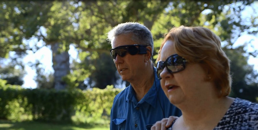 Terry Byland, who received a bionic eye (Argus II retina prosthesis) walking with his wife Sue.