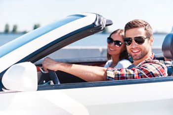 Couple driving in sunglasses