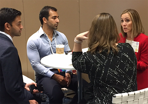 YOs chat with Academy coding expert Jenny Edgar during a Nov. 11 practice management roundtable at AAO 2017