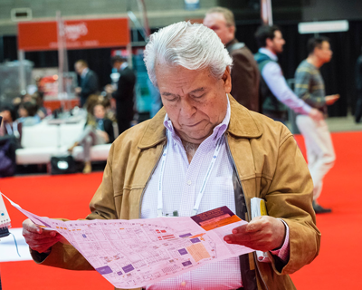 Attendee looking at Exhibition Floor Plan.