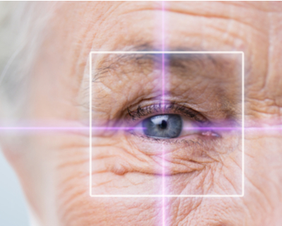Close-up photo of an elderly woman's eye through a target of light