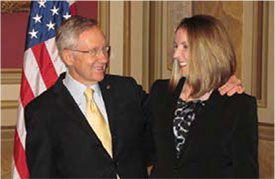 Lindsay Rhodes, MD, greets her former employer U.S. Sen. Harry Reid, D-Nev., during Congressional Advocacy Day. Dr. Rhodes worked in Sen. Reid's office prior to attending medical school.