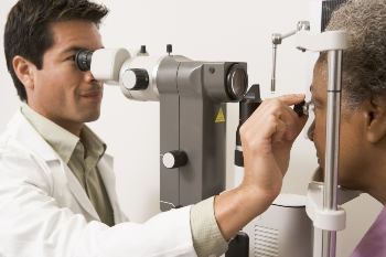 older woman gets an eye exam