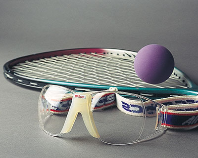 A photo of racquetball equipment with protective goggles