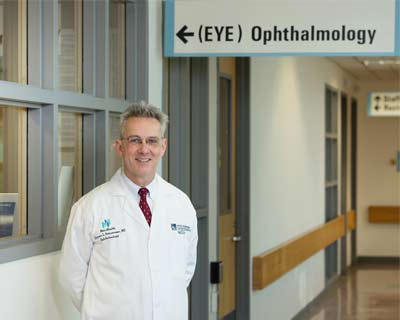 Thomas Steinemann, MD, stands outside the ophthalmology clinic in Cleveland, Ohio, where he treated Jeff Strayer for a devastating chemical burn to his eyes