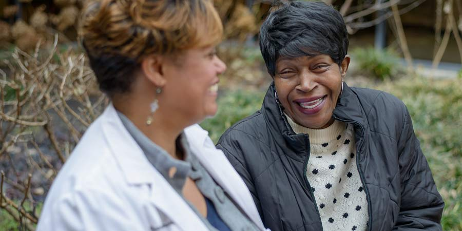 Peggy Wellman laughs with Dr. Chasidy Singleton, who saved Peggy's remaining vision from glaucoma.