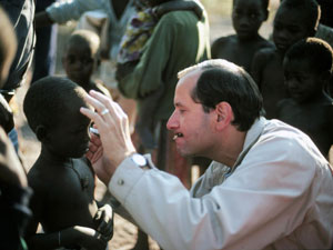 Dr. Sommer examines a child for trachoma and xerophthalmia, part of a 1989 survey in Zambia.