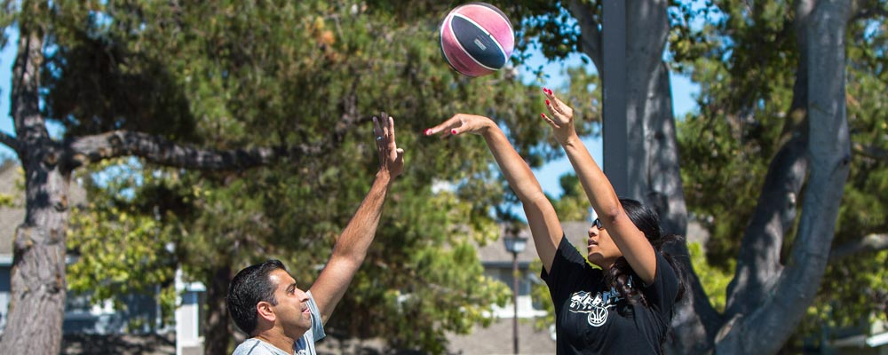 Dr. Khurana and Angellia play a game of one-on-one basketball