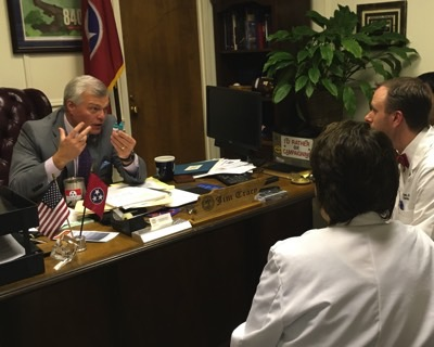 Jim Tracy, past member of the Tennessee Senate, meets with young ophthalmologists.