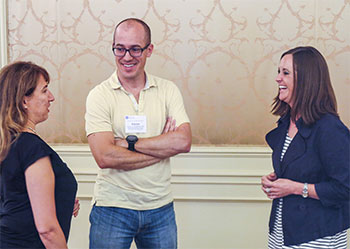Courtney Bovee, MD (right), talks to fellow ophthalmologists Chris Albanis, MD, and Aaron Holtebeck, MD, during a recent state secretariat meeting.