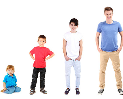 Four kids of different ages in colorful clothes