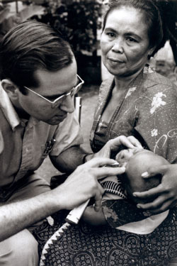 Dr. Sommer examines a child for xerophthalmia in Bandung, Indonesia, 1976.
