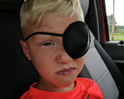 Colton Thompson wears eye patch after being injured by a fish hook in the eye.