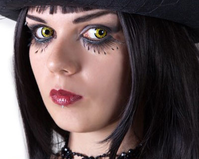 Photograph of a woman wearing a halloween costume and decorative contact lenses