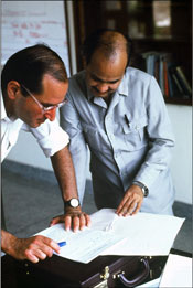 Dr. Sommer reviews data with a colleague in Nepal, 1994.