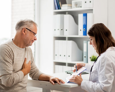 Photograph of a man talking with his cardiologist