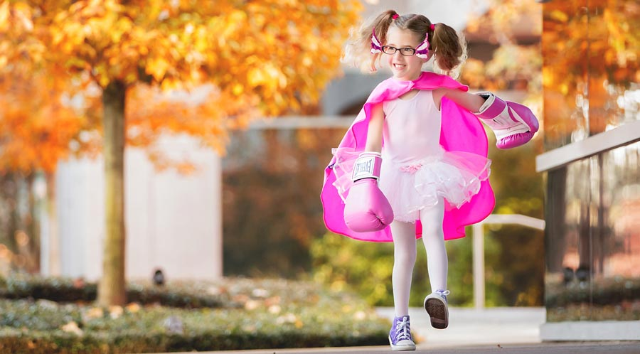 Callie outdoors in ballet outfit and pink boxing gloves