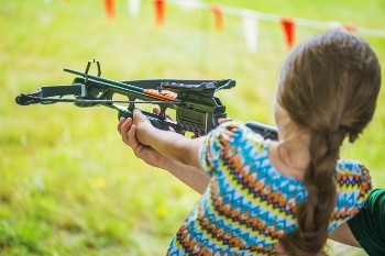 Girl aiming crossbow