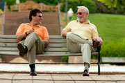 Men on a bench wearing sunglasses