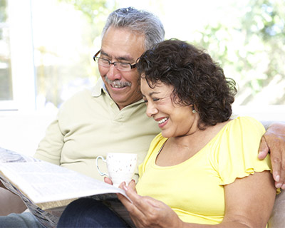 Photograph of older couple reading together